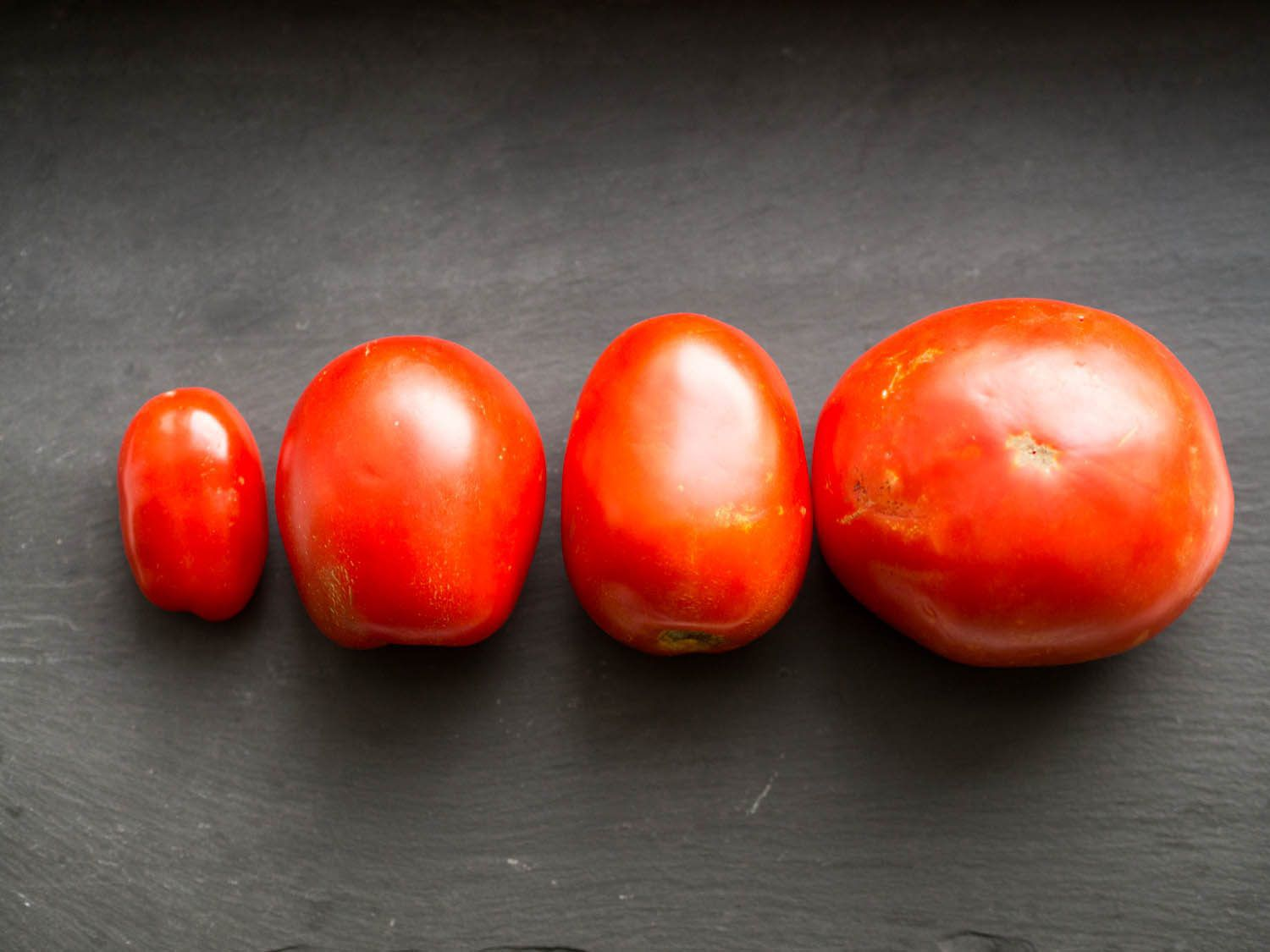 Different varieties of fresh whole tomatoes