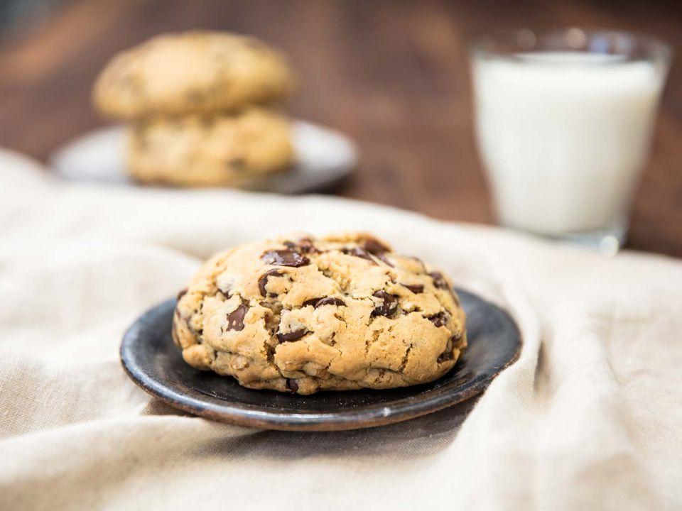 Levain Bakery-style super thick chocolate chip cookie with milk.