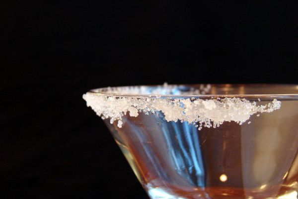 Sugar on the rim of a cocktail glass.