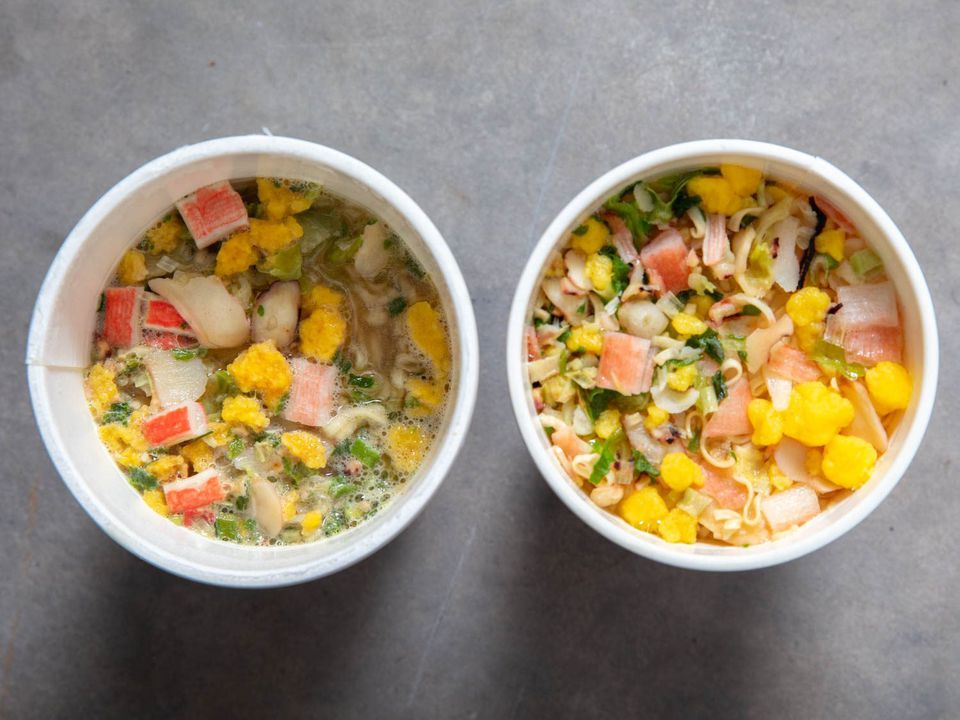 Overhead comparison shot of American Seafood Cup Noodle (left) and Japanese Seafood Cup Noodle (right)