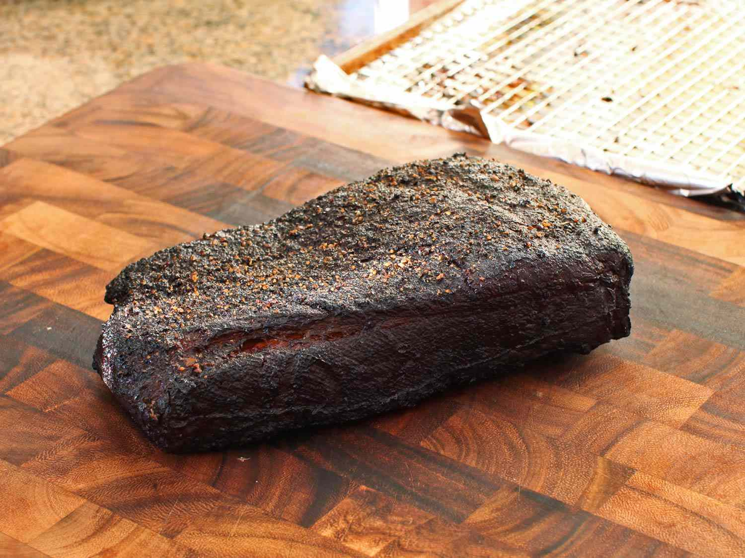 Finished brisket that's been cooked sous vide and then smoked, with a blackened bark