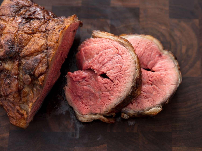 Overhead of sliced tri-tip roast on a cutting board