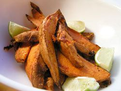 Sweet potato fries with lime wedges