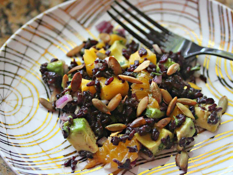 Fruity Black Rice Salad With Cilantro, Avocado, and Pepitas in Chili-Orange Vinaigrette