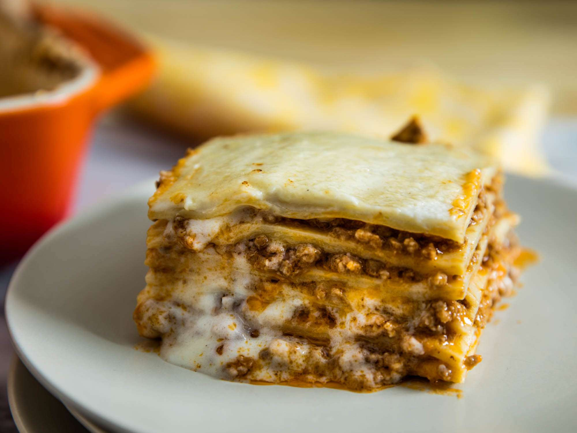 A serving of lasagna bolognese on a plate.