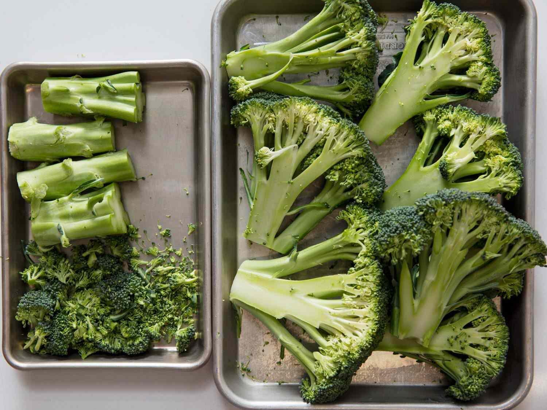 Broccoli cut into steaks, stems, and floret scraps.