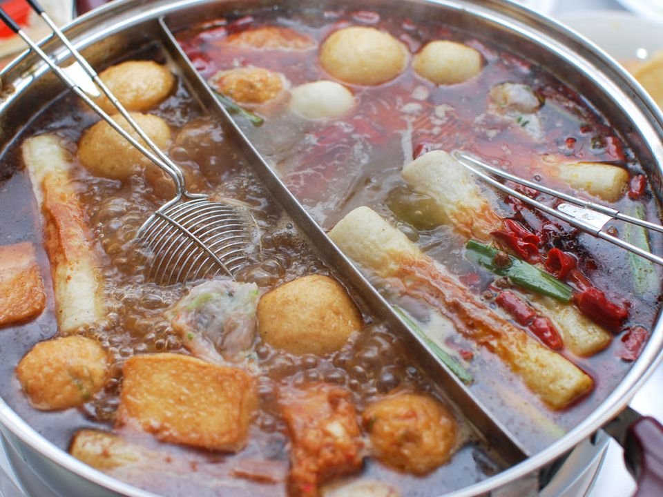 Assorted ingredients simmer in a Chinese hot pot.