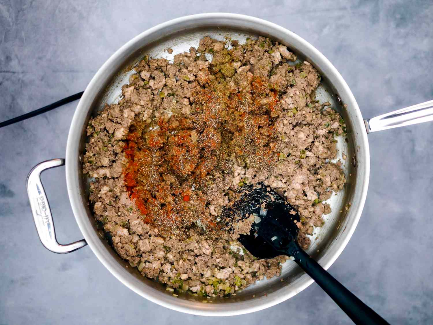 ground meat and vegetable mixture returned to skillet with seasoning