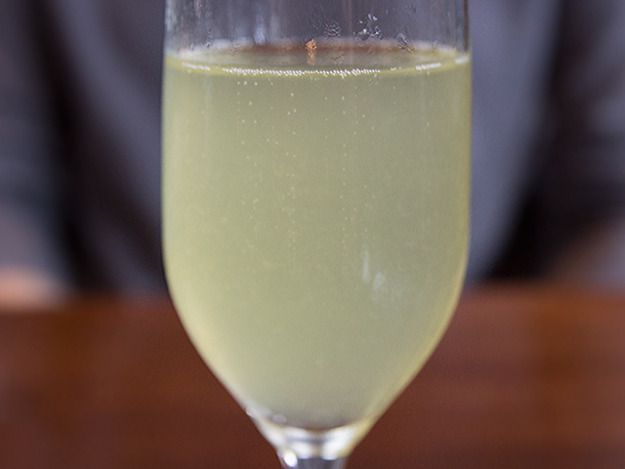 A glass of a cocktail called The Blur.