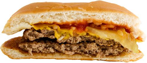 A McDouble cheeseburger cut in half, showing two patties and one slice of cheese.