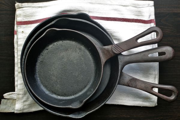 Three Cast Iron Skillets stacked inside each other.