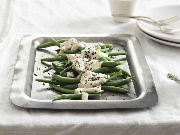 White Tofu, Sesame, and Vegetable Salad on a metal plate.