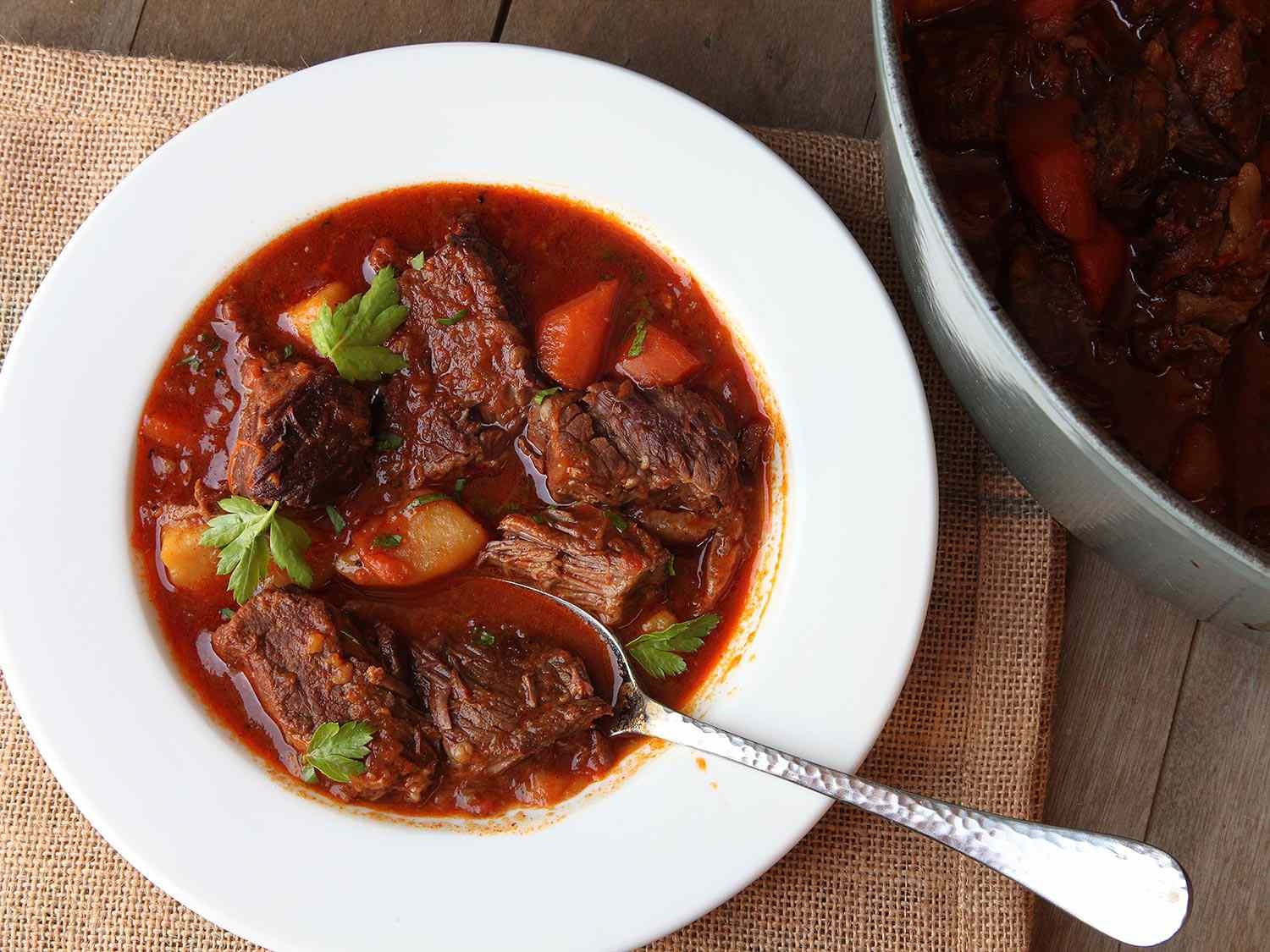 Hungarian Goulash (Beef Stew With Paprika) in a white bowl.