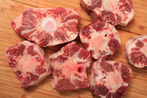 raw slices of oxtail before searing