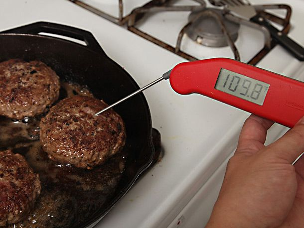 taking temperature of beef patties