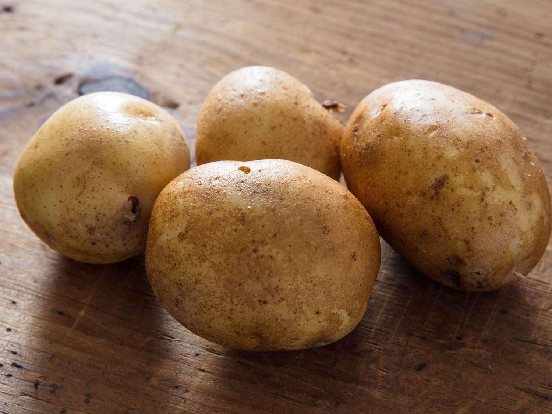 Yukon gold potatoes on a cutting board