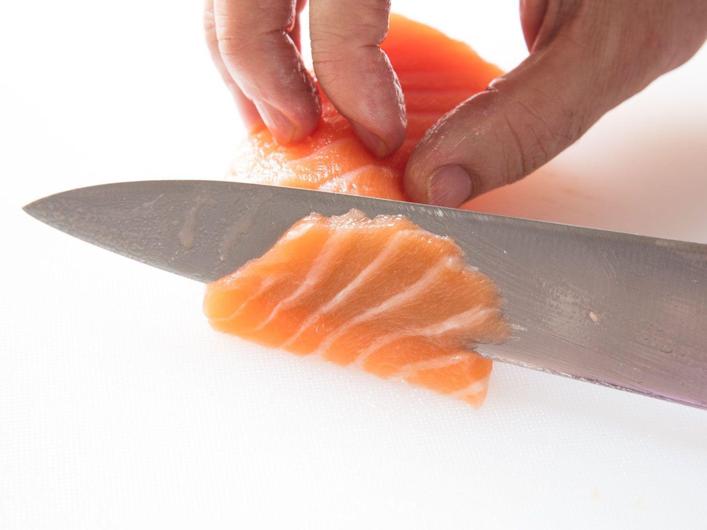 slicing salmon for tiradito (a type of Peruvian ceviche)