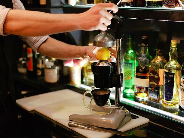 bartender juicing a lemon