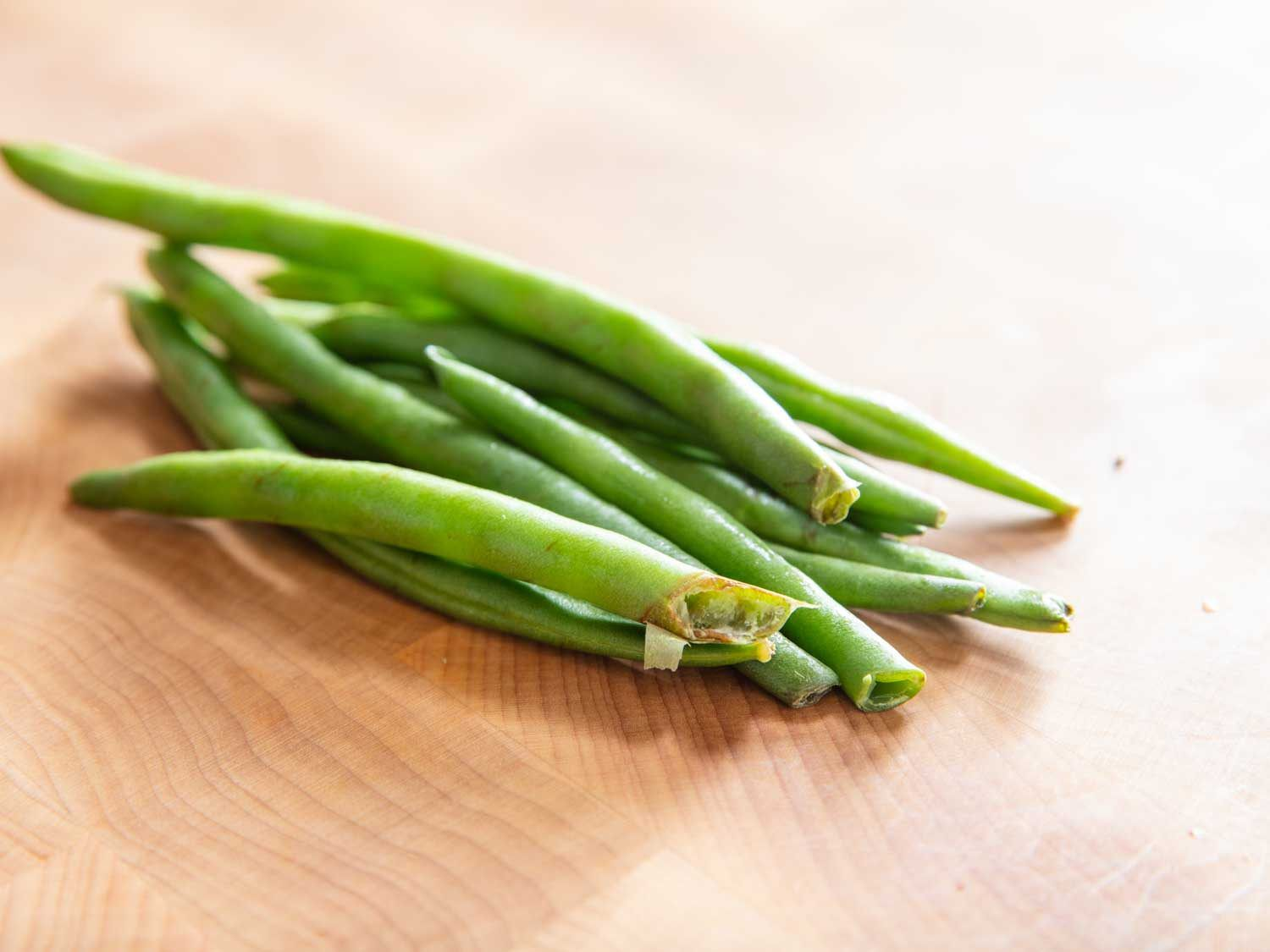 Green beans with damaged stem ends.