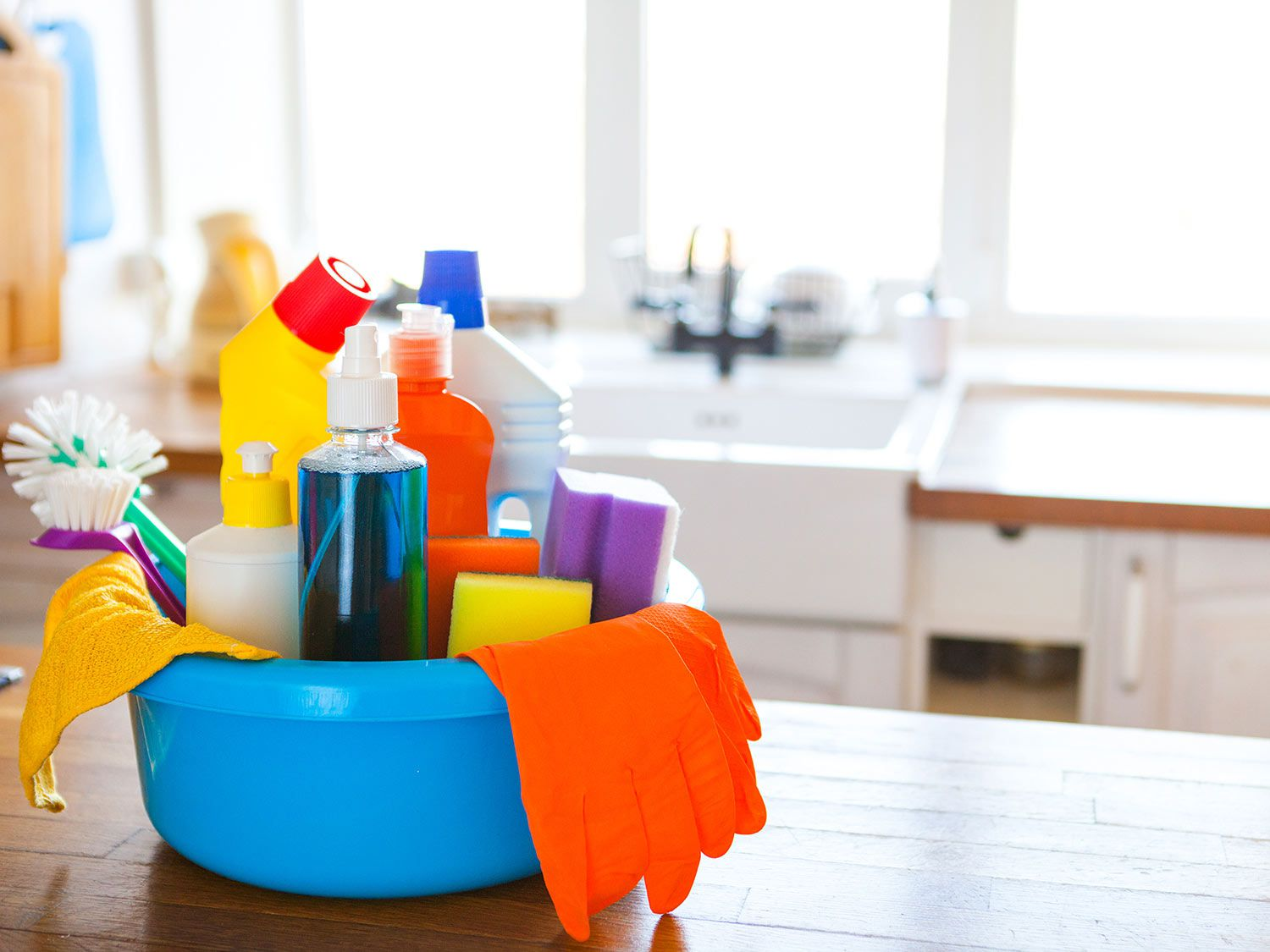 Bucket of kitchen-cleaning products