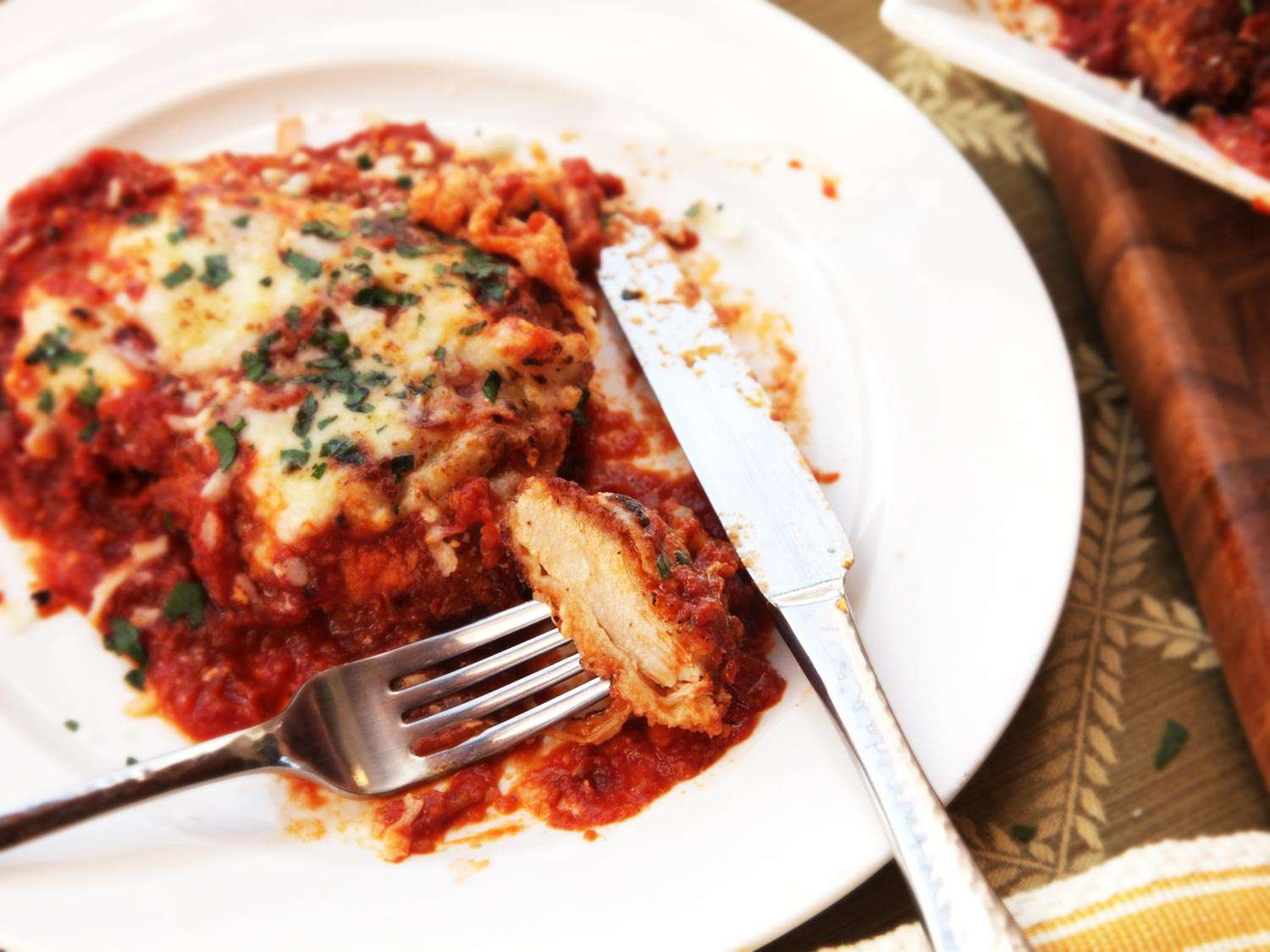 A forkful of chicken parmesan