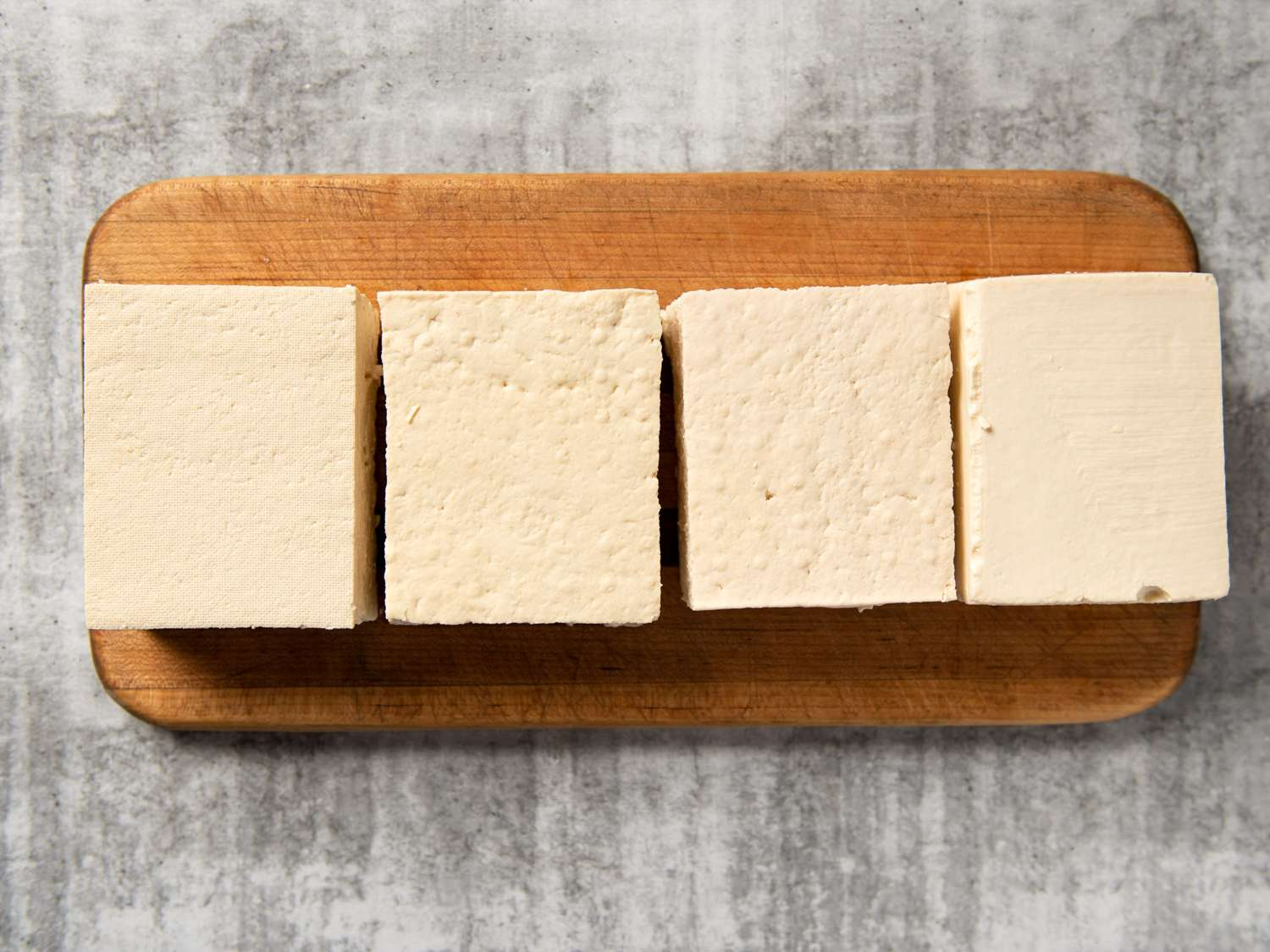 a group of different block tofu of varying firmness