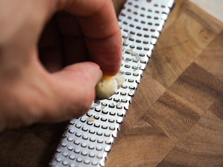 Grating garlic on a microplane.