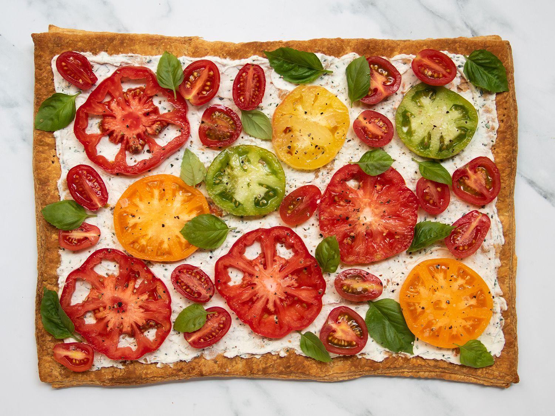 Sliced tomato tart on a marble countertop