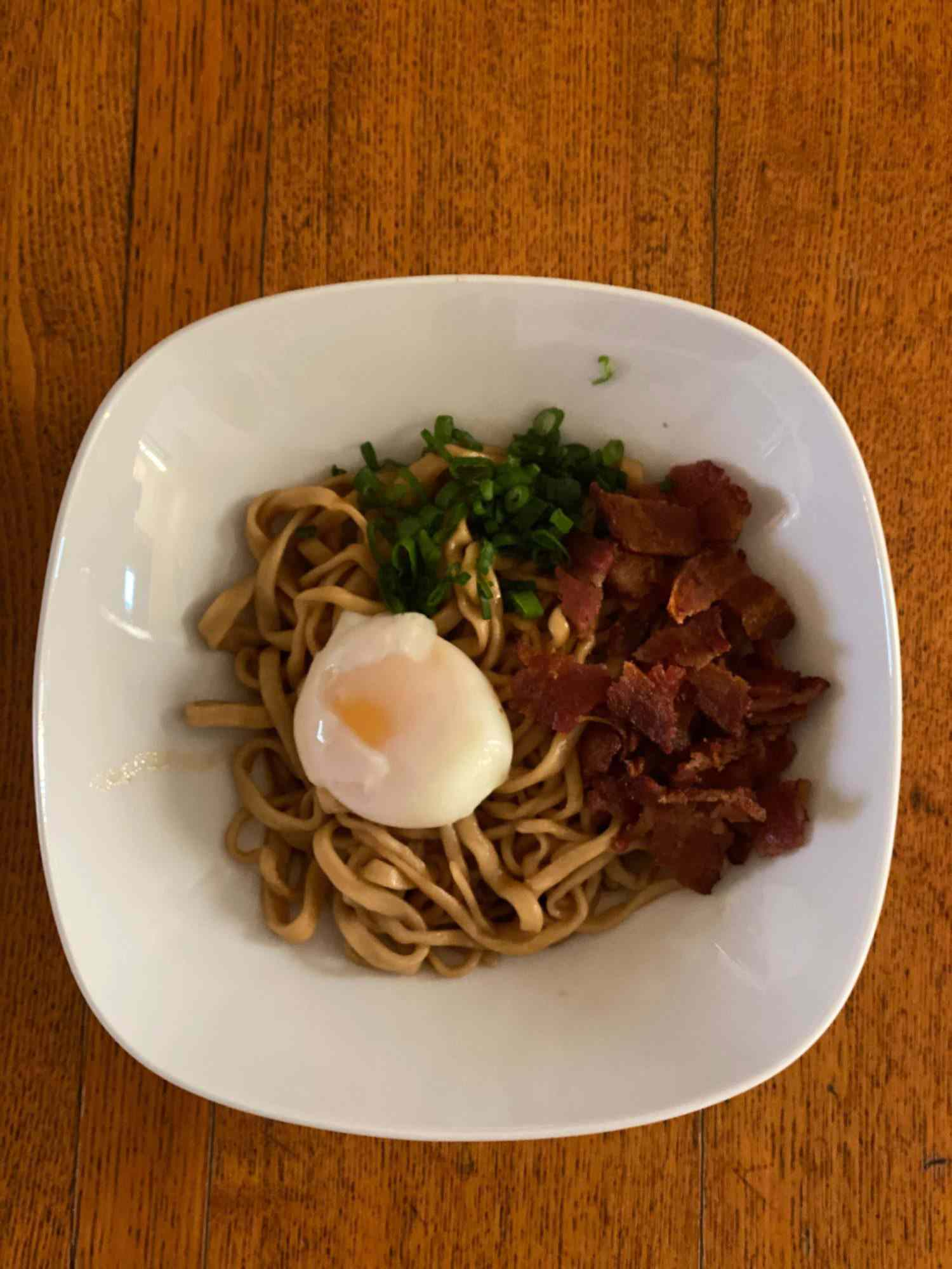 Overhead view of bowl of bacon and egg mazemen