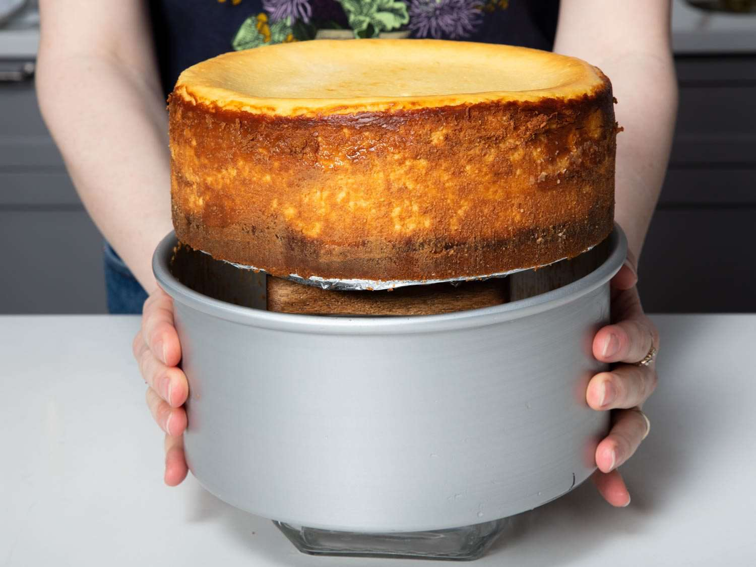 removing the sides of a loose bottom cheesecake pan by sliding downward over a tall object