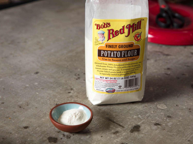 An open bag of potato flour, next to a small pinch bowl of potato flour