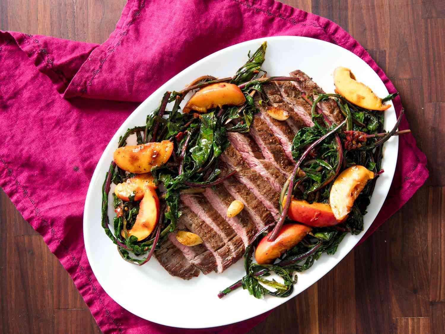 pan-seared flank steak with dandelion and peach