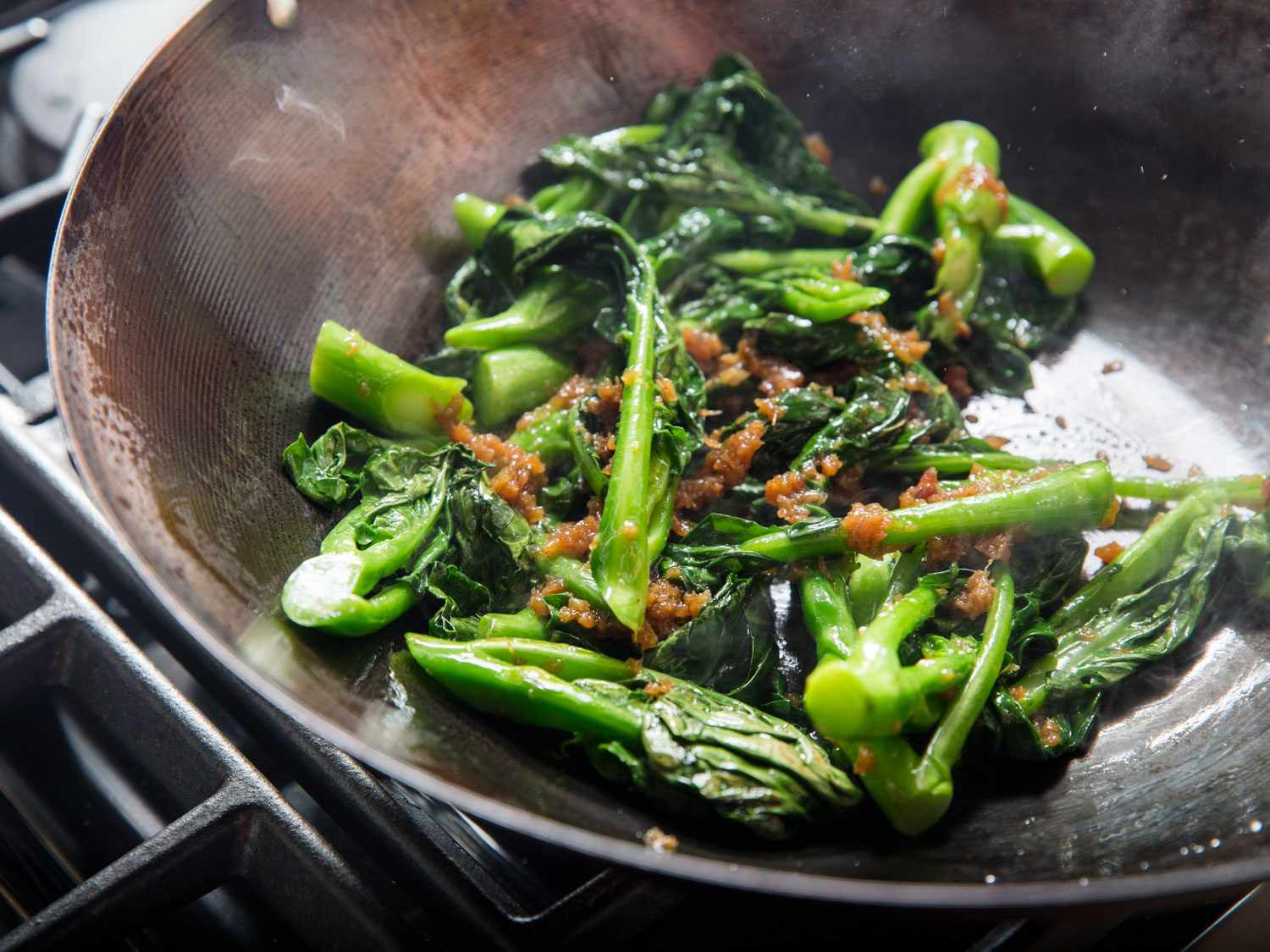 Stir-frying Chinese broccoli with XO sauce.