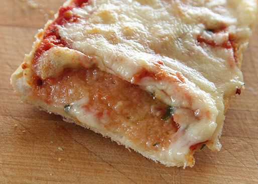 A picture of French bread pizza where the sauce was put directly on the bread and it had soggy results.