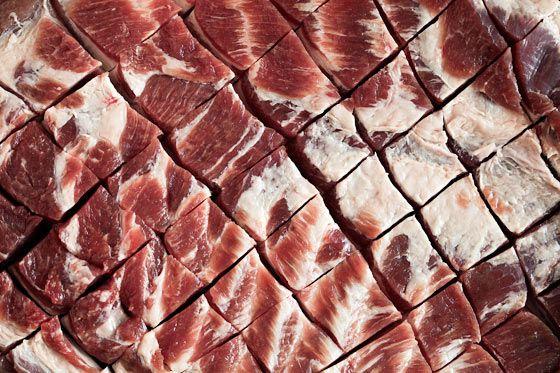 Cross scoring pork belly for porchetta