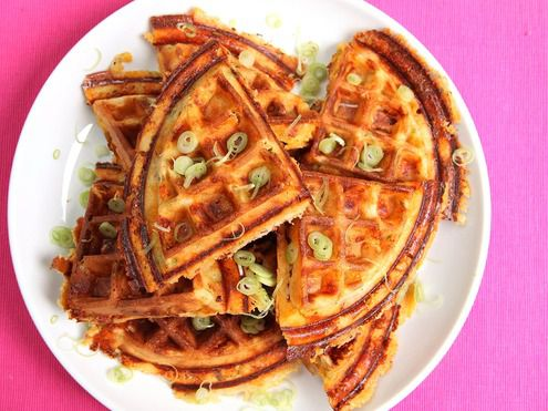 A plate full of bacon scallion waffles.