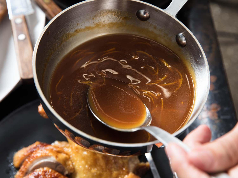 A saucepan of bigarade sauce for Duck à l'Orange