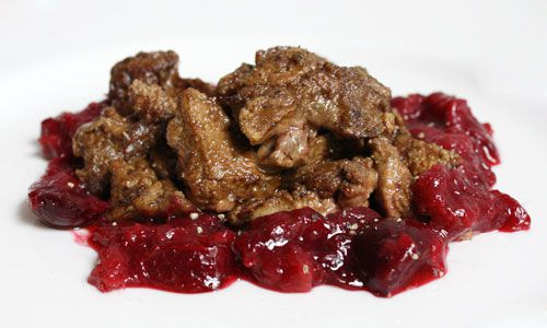 Cooked duck livers served with a rhubarb and cherry sauce.