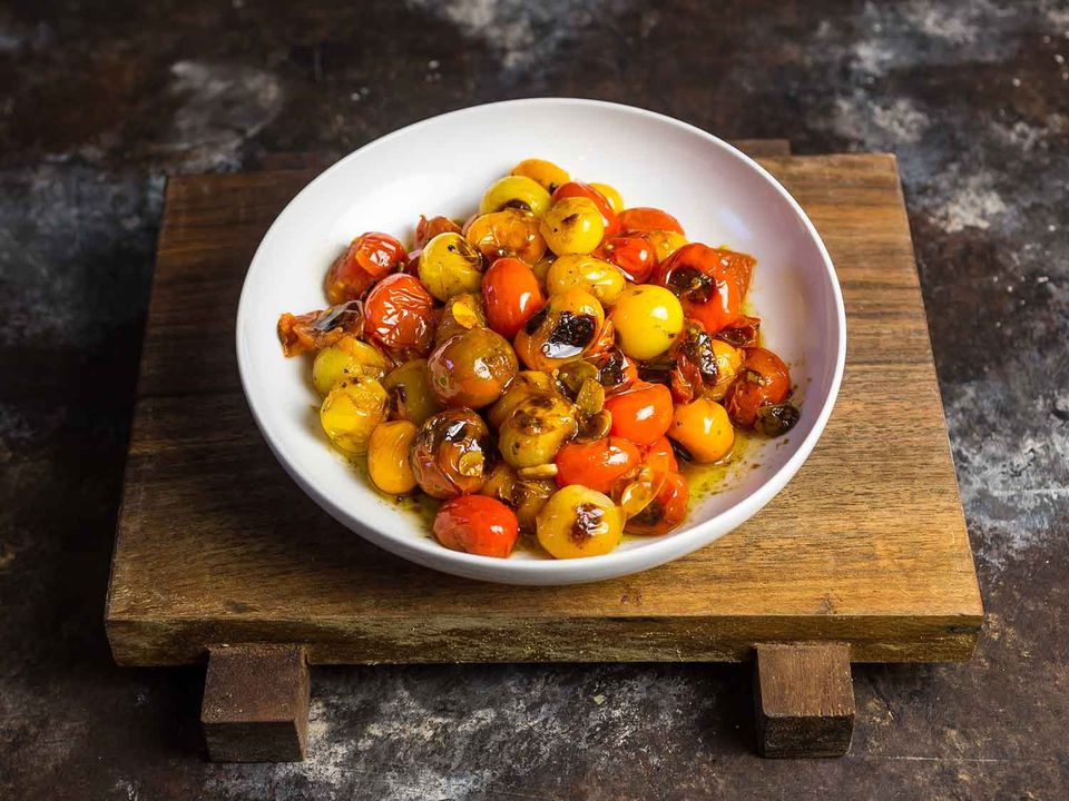 Overhead view of bowl of cherry tomatoes on a