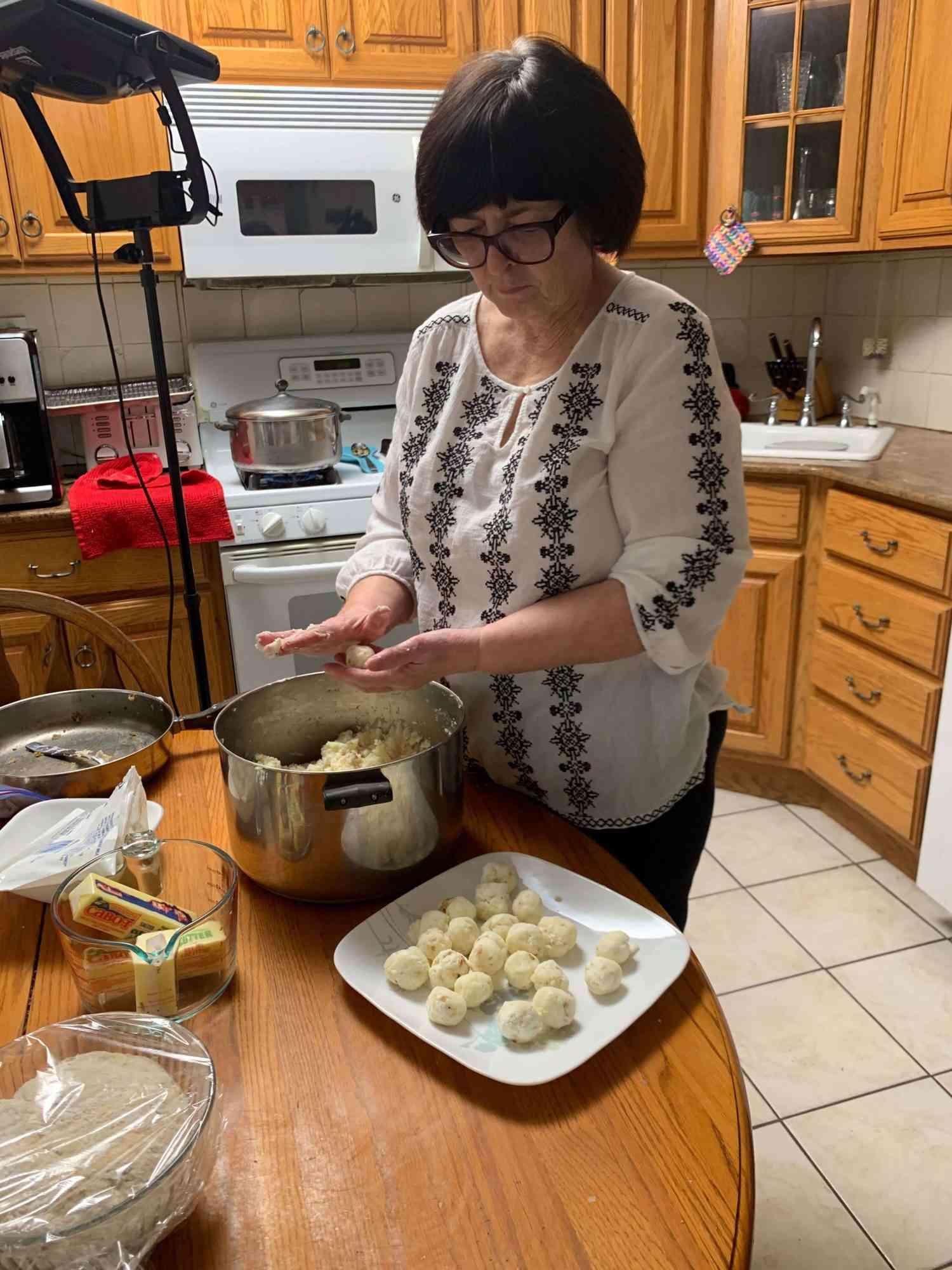 Vicky's mom making pierogi