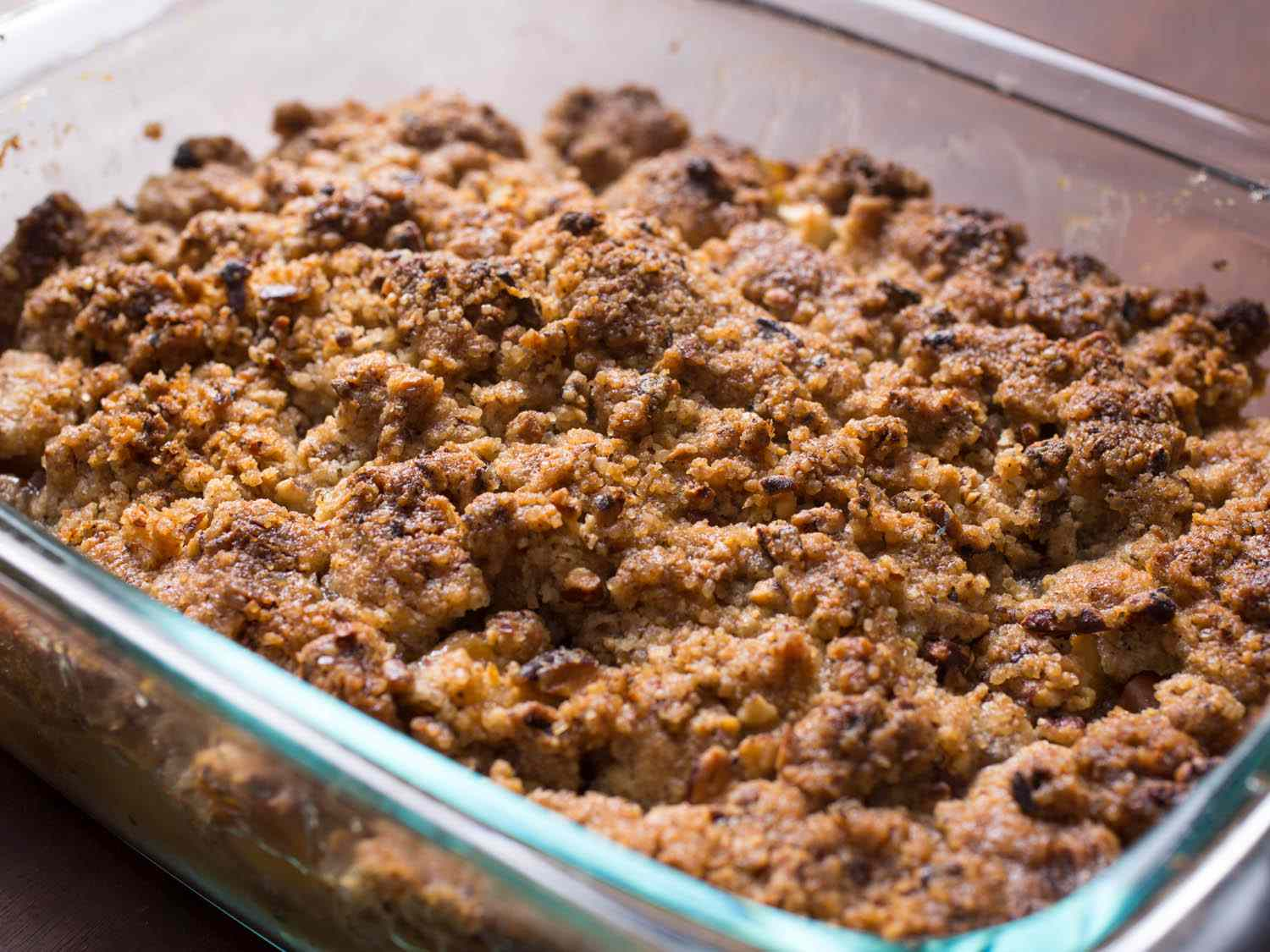 A glass baking dish of apple crisp with a crumble topping