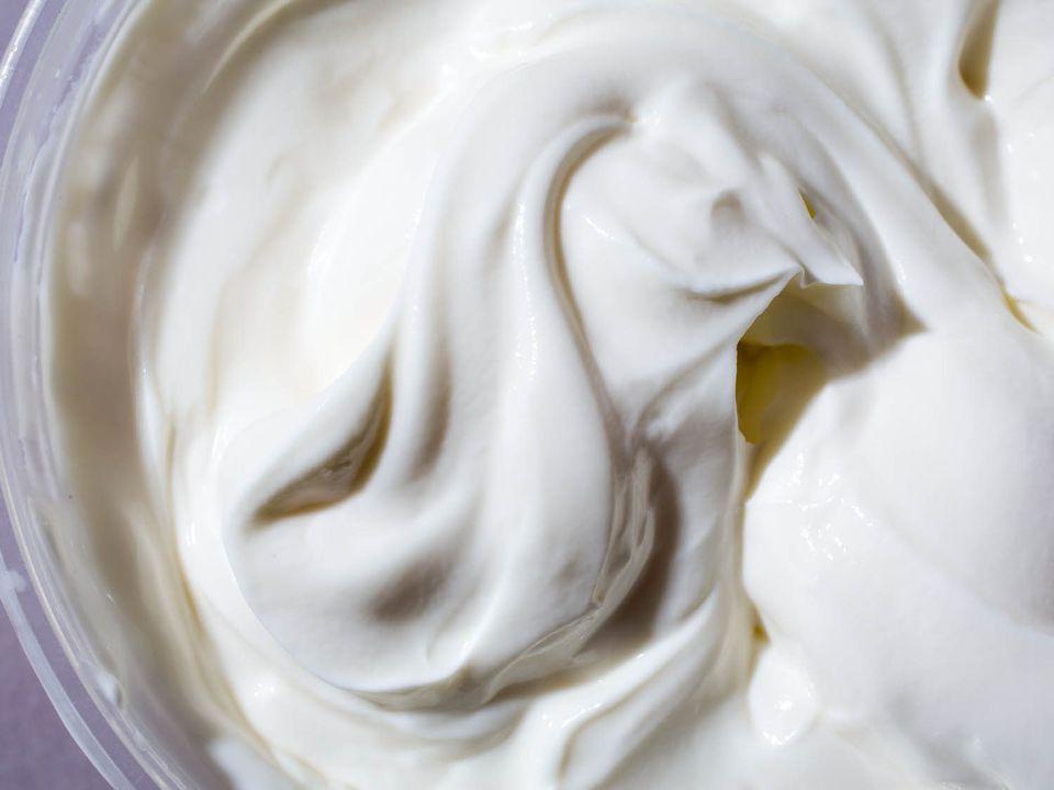 Thick swirls of yogurt in a bowl.
