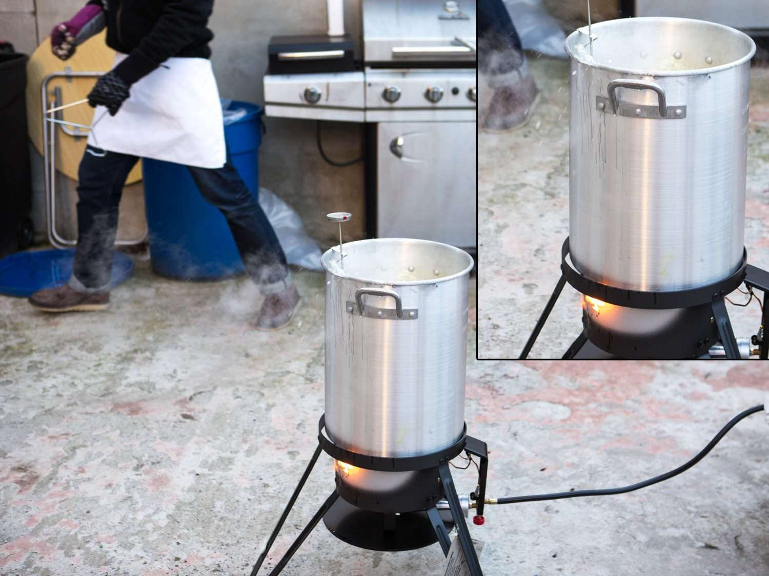 Boiling fat shooting out of kettle in which turkey is being deep fried