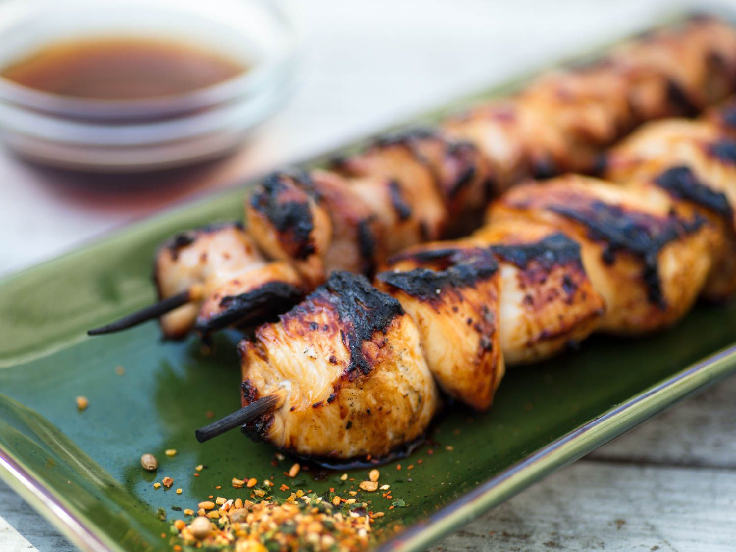 Grilled sweet-and-sour chicken skewers (yakitori nanbansu) on a green dish