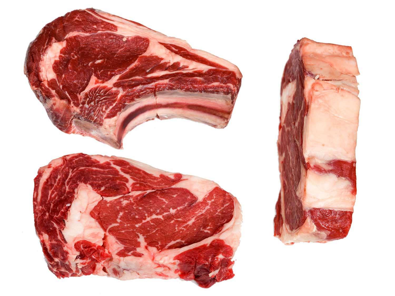 Three uncooked ribeye steaks