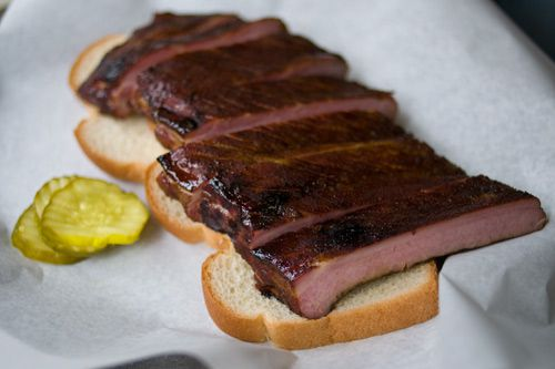 Saint Louis style ribs on two slices of bread with pickles