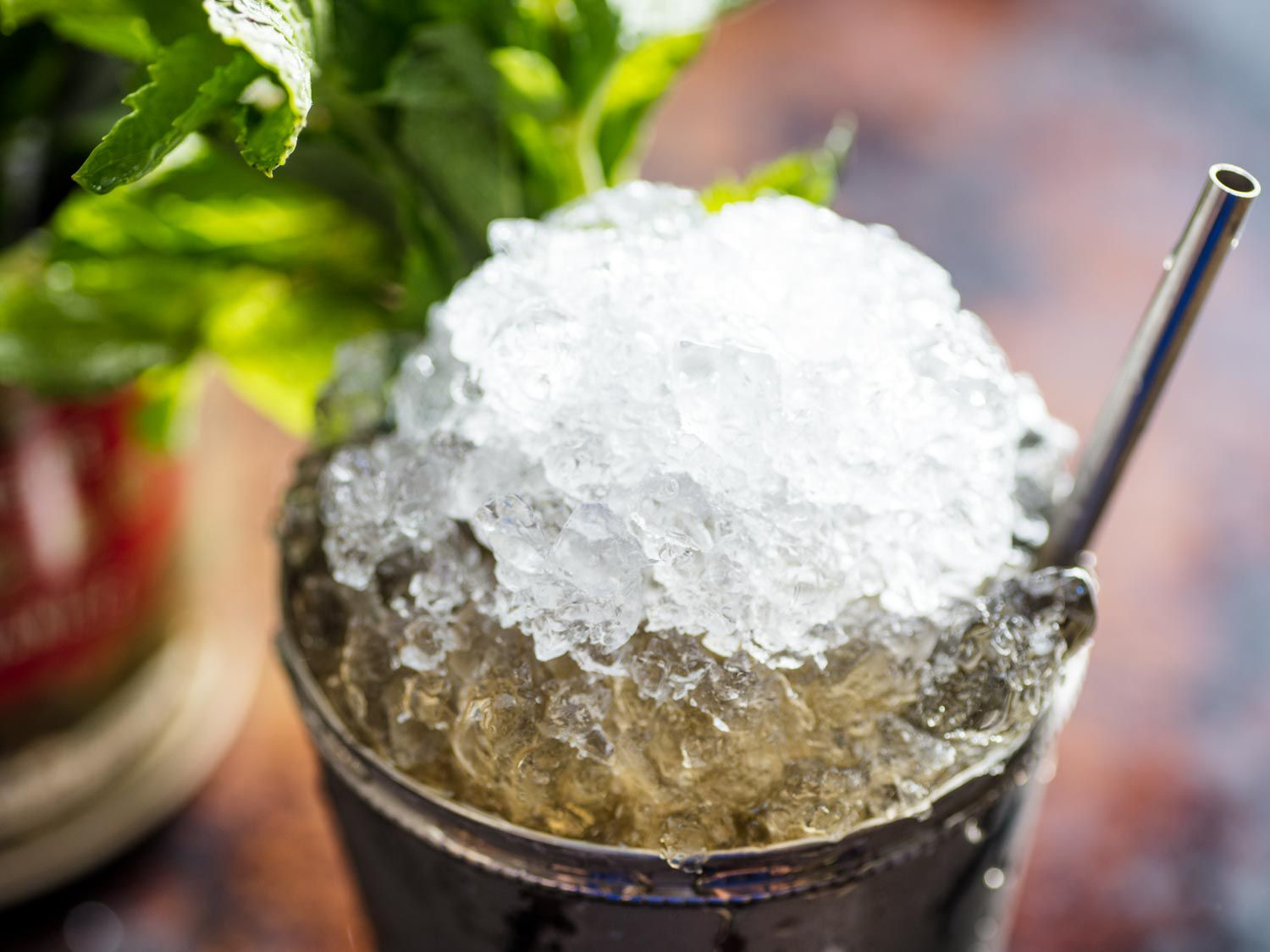 Close-up of a mound of crushed ice on top of a julep cup