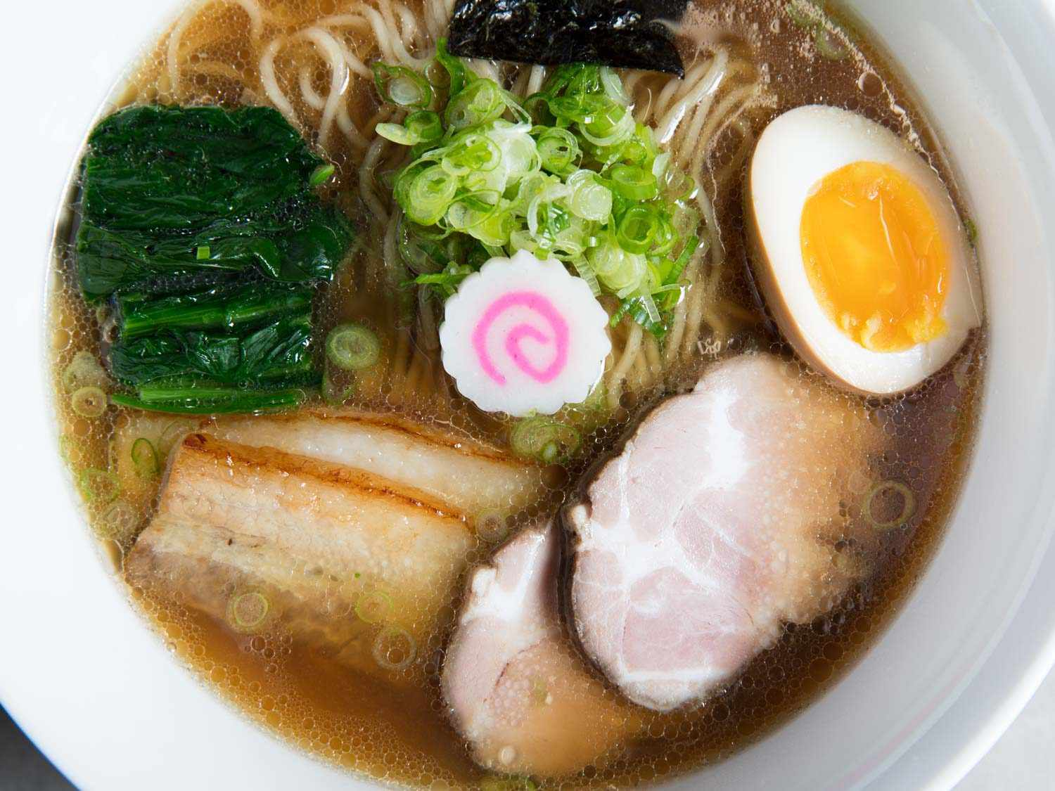 Close-up overhead shot of a bowl of shoyu ramen with garnishes