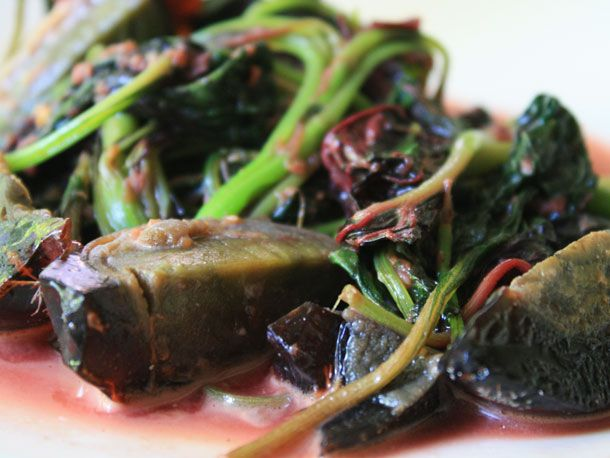 Boiled greens with a preserved duck egg.
