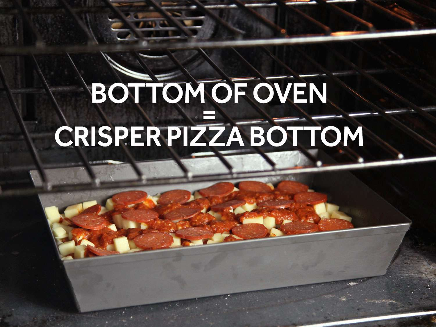 A pan of Detroit-style pizza placed on oven floor